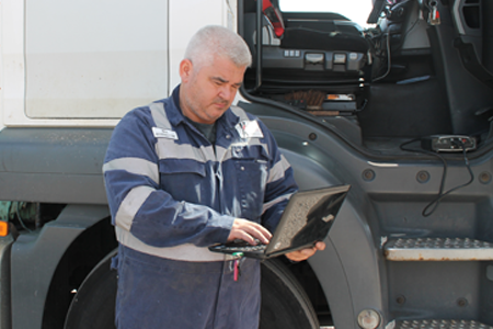 mechanic operating a brake diagnostics machine