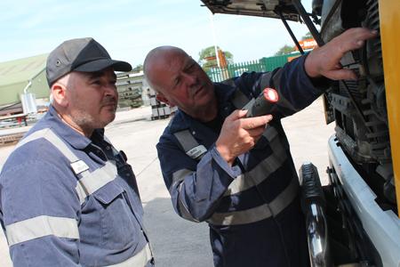 HGV mobile technicians fixing a problem roadside