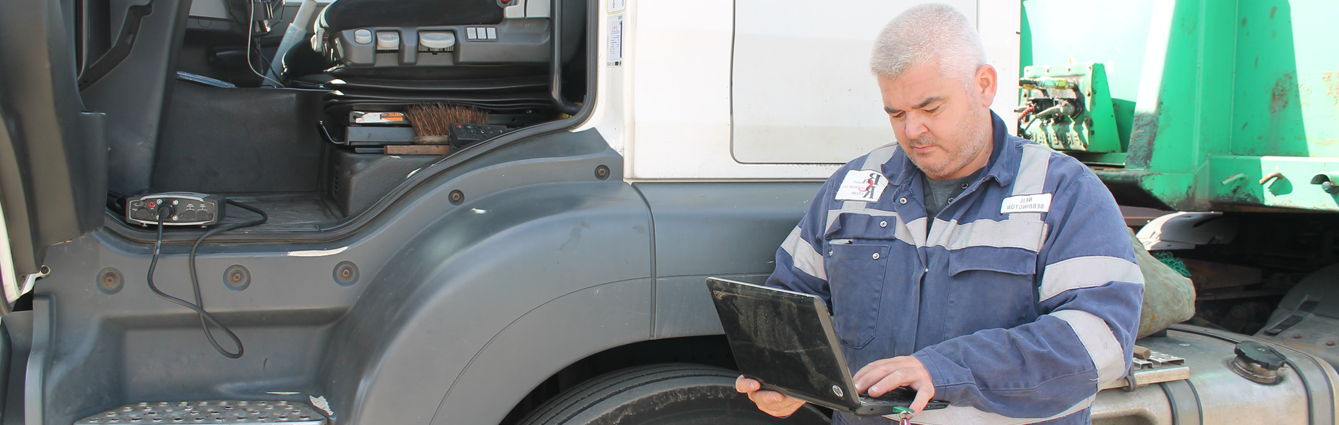 A mechanic running diagnostics on a HGV